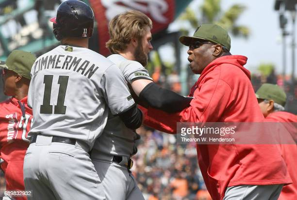 Manager Dusty Baker and Ryan Zimmerman of the Washington Nationals pulls Bryce Harper away from a fight after Harper was hit by a pitch from Hunter...