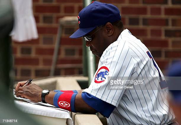 Manager Dusty Baker of the Chicago Cubs makes notes in the dugout before a game against the Chicago White Sox on July 1 2006 at Wrigley Field in...