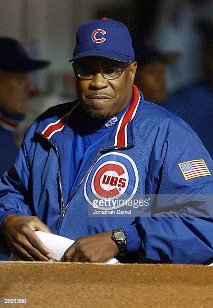 Manager Dusty Baker of the Chicago Cubs watches from the dugout in the first inning against the Florida Marlins in Game 6 of the National League...