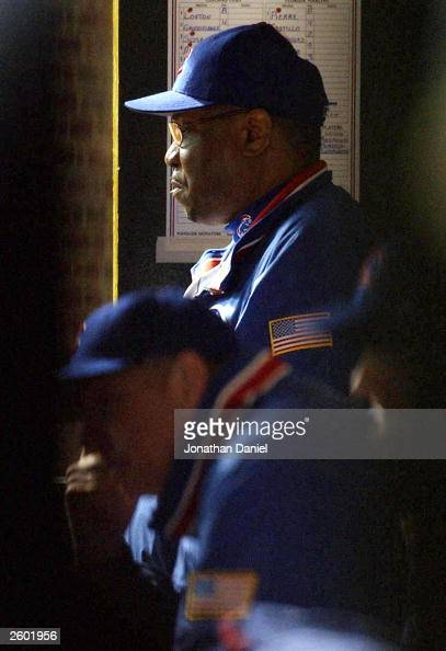 Manager Dusty Baker of the Chicago Cubs watches from the dugout in the seventh inning against the Florida Marlins during game seven of the National...