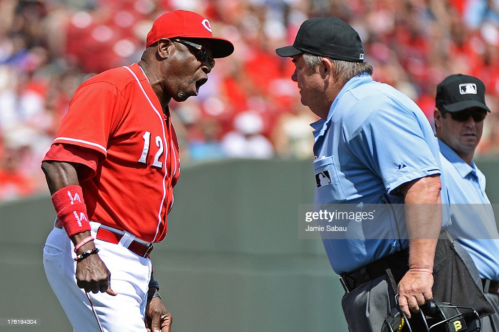 Manager <a gi-track='captionPersonalityLinkClicked' href=/galleries/search?phrase=Dusty+Baker&family=editorial&specificpeople=202908 ng-click='$event.stopPropagation()'>Dusty Baker</a> #12 of the Cincinnati Reds argues a call with home plate umpire Joe West in the seventh inning against the San Diego Padres at Great American Ball Park on August 11, 2013 in Cincinnati, Ohio. Cincinnati defeated San Diego 3-2 in 13 innings.