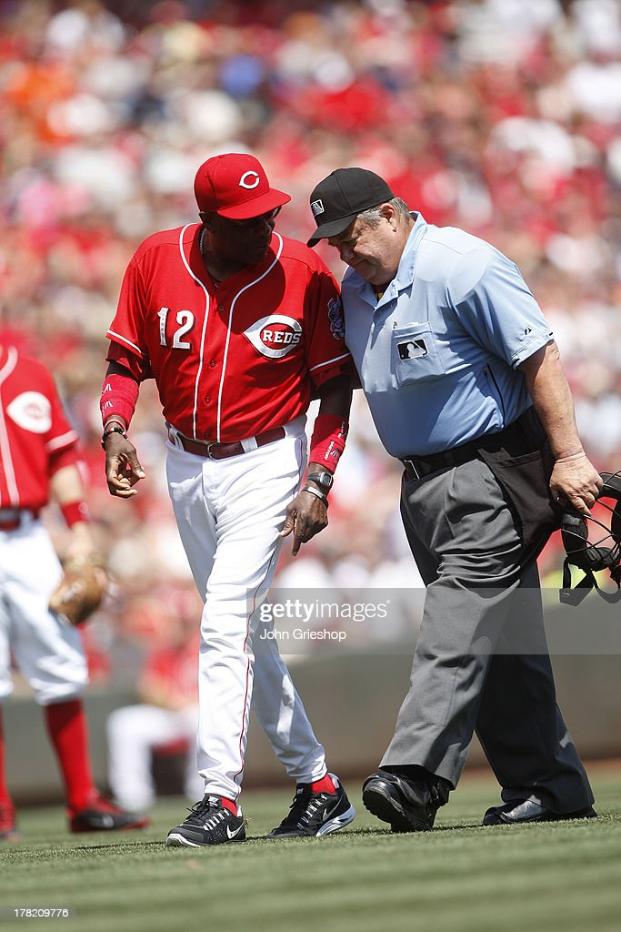 Manager Dusty Baker #12 of the Cincinnati Reds argues a call with home plate umpire Joe West #35 during the game against the San Diego Padres on Sunday, August 11, 2013 at Great American Ball Park in Cincinnati, Ohio. The Reds defeated the Padres 3-2 in 13 innings.