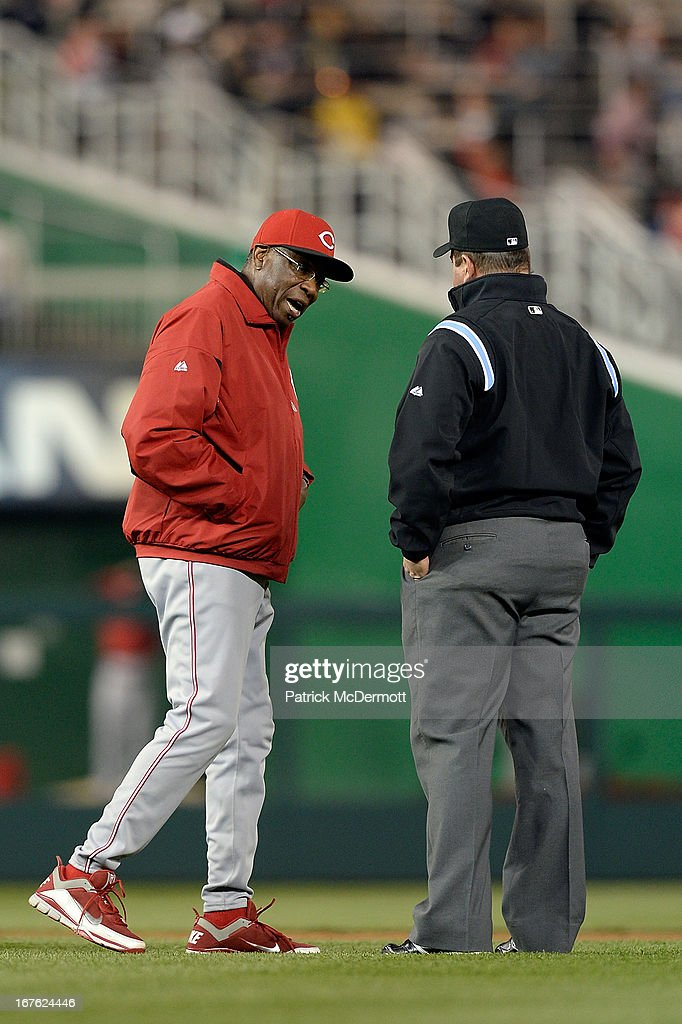 Manager <a gi-track='captionPersonalityLinkClicked' href=/galleries/search?phrase=Dusty+Baker&family=editorial&specificpeople=202908 ng-click='$event.stopPropagation()'>Dusty Baker</a> #12 of the Cincinnati Reds argues a call with second base umpire Sam Holbrook during the sixth inning of a game against the Washington Nationals at Nationals Park on April 26, 2013 in Washington, DC.