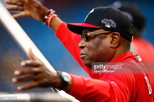 Manager Dusty Baker of the Cincinnati Reds looks on during batting practice prior to their National League Wild Card game against the Pittsburgh...
