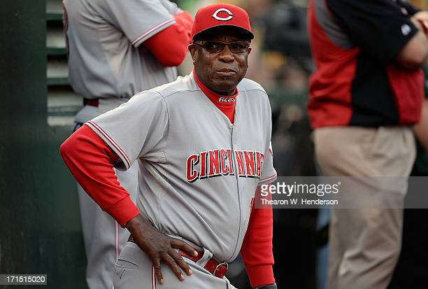 Manager Dusty Baker of the Cincinnati Reds looks on from the dugout against the Oakland Athletics at Oco Coliseum on June 25 2013 in Oakland...