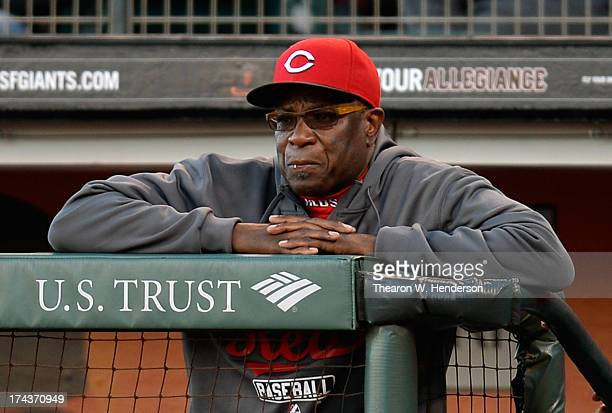 Manager Dusty Baker of the Cincinnati Reds looks on from the dugout against the San Francisco Giants at ATT Park on July 24 2013 in San Francisco...