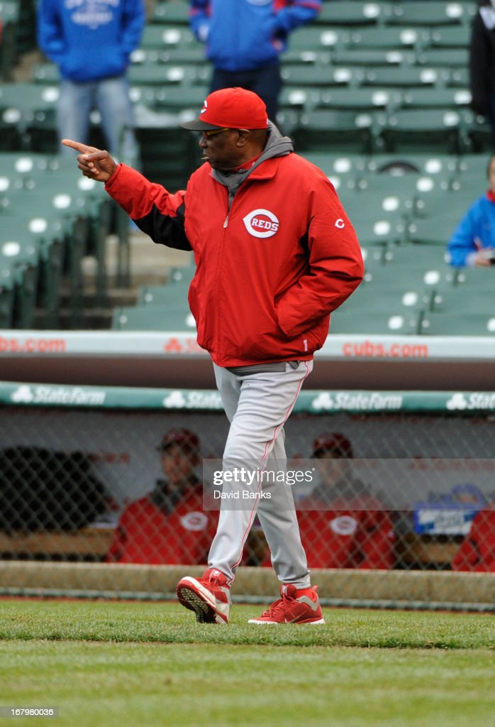 Manager <a gi-track='captionPersonalityLinkClicked' href=/galleries/search?phrase=Dusty+Baker&family=editorial&specificpeople=202908 ng-click='$event.stopPropagation()'>Dusty Baker</a> #12 of the Cincinnati Reds makes a pitching change in the ninth inning against the Chicago Cubs on May 3, 2013 at Wrigley Field in Chicago, Illinois. The Reds defeated the Cubs 6-5.