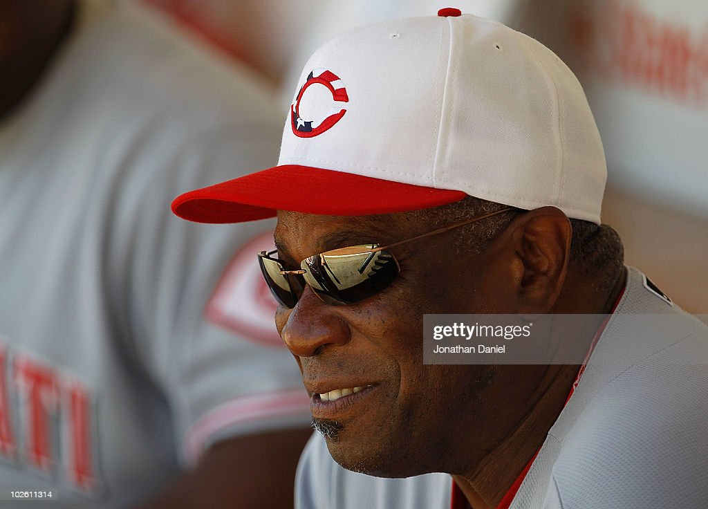 Manager <a gi-track='captionPersonalityLinkClicked' href=/galleries/search?phrase=Dusty+Baker&family=editorial&specificpeople=202908 ng-click='$event.stopPropagation()'>Dusty Baker</a> #12 of the Cincinnati Reds smiles while sitting on the bench before a game against the Chicago Cubs at Wrigley Field on July 3, 2010 in Chicago, Illinois. The Cubs defeated the Reds 3-1.