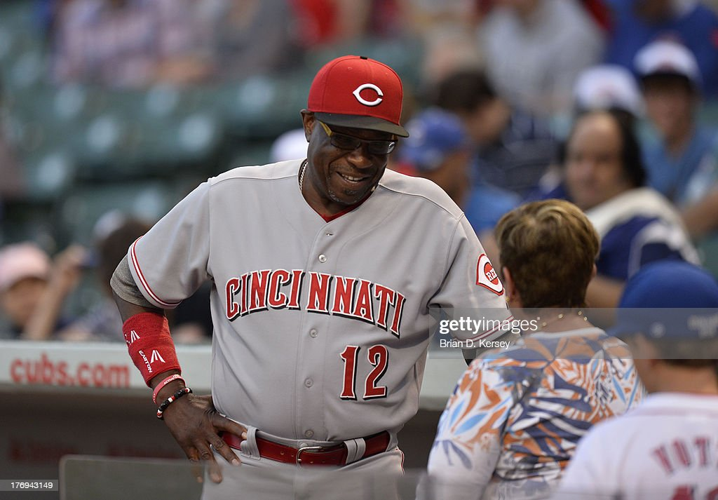 Manager Dusty Baker #12 of the Cincinnati Reds talks to fans before the game against the Chicago Cubs at Wrigley Field on August 12, 2013 in Chicago, Illinois. The Reds defeated the Cubs 2-0.