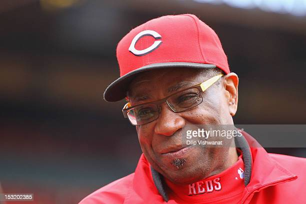 Manager Dusty Baker of the Cincinnati Reds talks to members of the media during batting practice prior to playing against the St Louis Cardinals at...