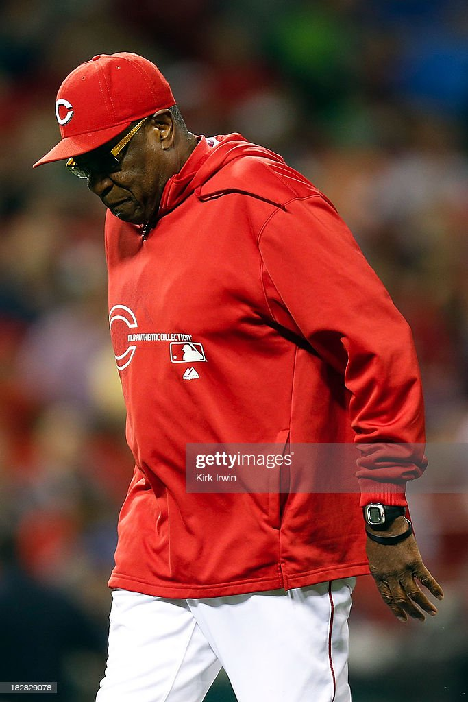 Manager Dusty Baker of the Cincinnati Reds walks back to the dugout after talking with his players during the game against the New York Mets at Great American Ball Park on September 23, 2013 in Cincinnati, Ohio. Cincinnati defeated New York 3-2 in 10 innings.