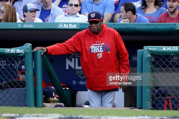 Manager Dusty Baker of the Washington Nationals looks on from the dugout in the sixth inning against the Chicago Cubs during game three of the...