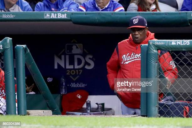 Manager Dusty Baker of the Washington Nationals looks on from the dugout in the sixth inning during game four of the National League Division Series...
