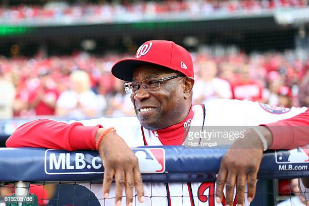 Manager Dusty Baker of the Washington Nationals looks on from the dugout prior to Game 1 of NLDS against the Los Angeles Dodgers at Nationals Park on...