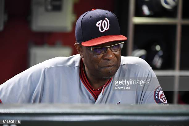 Manager Dusty Baker of the Washington Nationals looks on from the dugout during the first inning against the Arizona Diamondbacks at Chase Field on...