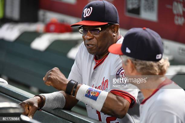 Manager Dusty Baker of the Washington Nationals talks with bench coach Chris Speier prior to the start of a game against the Arizona Diamondbacks at...