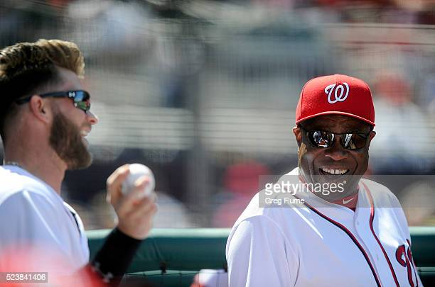 Manager Dusty Baker of the Washington Nationals talks with Bryce Harper during the fourth inning of the game against the Minnesota Twins at Nationals...