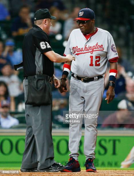 Manager Dusty Baker of the Washington Nationals talks with home plate umpire Chad Whitson after a hitbypitch was overruled in the 11th inning at...