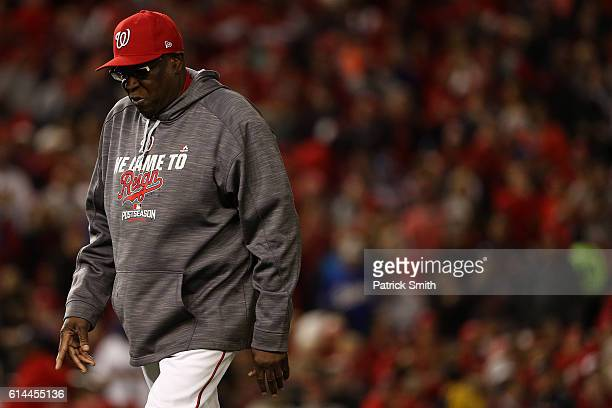Manager Dusty Baker of the Washington Nationals walks off of the field in the seventh inning against the Los Angeles Dodgers during game five of the...