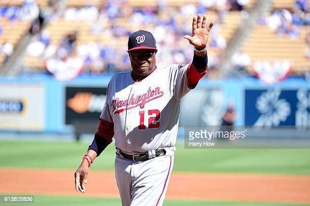 Manager Dusty Baker of the Washington Nationals waves during player introductions before game three of the National League Division Series against...