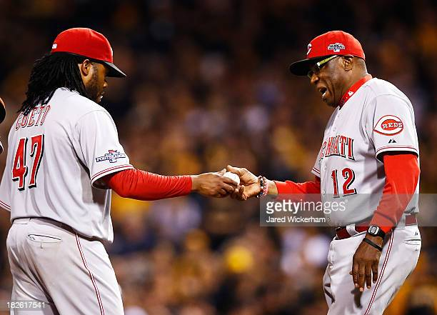 Manager Dusty Baker pulls Johnny Cueto of the Cincinnati Reds in the fourth inning against the Pittsburgh Pirates during the National League Wild...