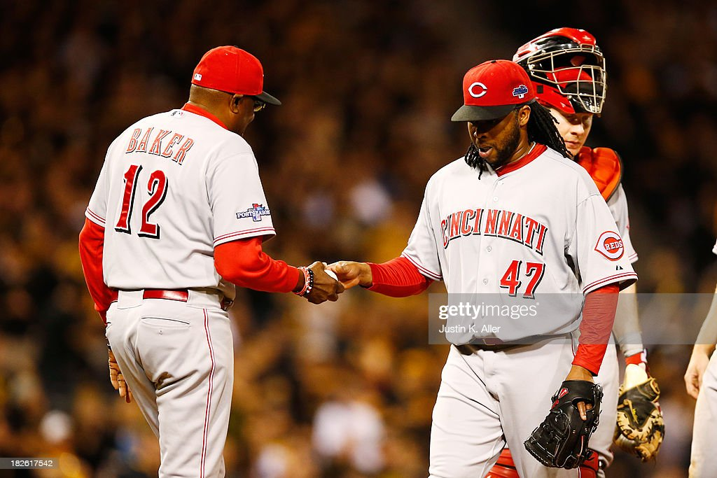 Manager Dusty Baker #12 pulls Johnny Cueto #47 of the Cincinnati Reds in the fourth inning against the Pittsburgh Pirates during the National League Wild Card game at PNC Park on October 1, 2013 in Pittsburgh, Pennsylvania.