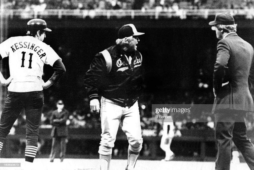 Manager <a gi-track='captionPersonalityLinkClicked' href=/galleries/search?phrase=Earl+Weaver&family=editorial&specificpeople=213180 ng-click='$event.stopPropagation()'>Earl Weaver</a> #4 of the Baltimore Orioles argues with umpire Larry Barnett as manager/player Don Kessinger #11 of the Chicago White Sox looks on after beating out a base hit on June 12, 1979 at Comiskey Park in Chicago, Illinois.