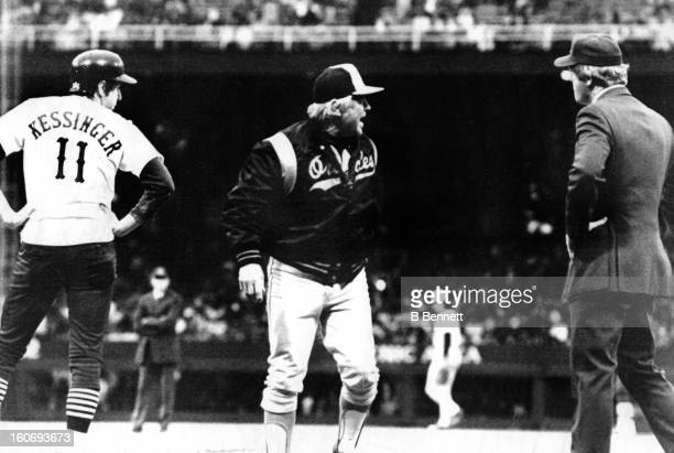 Manager Earl Weaver of the Baltimore Orioles argues with umpire Larry Barnett as manager/player Don Kessinger of the Chicago White Sox looks on after...