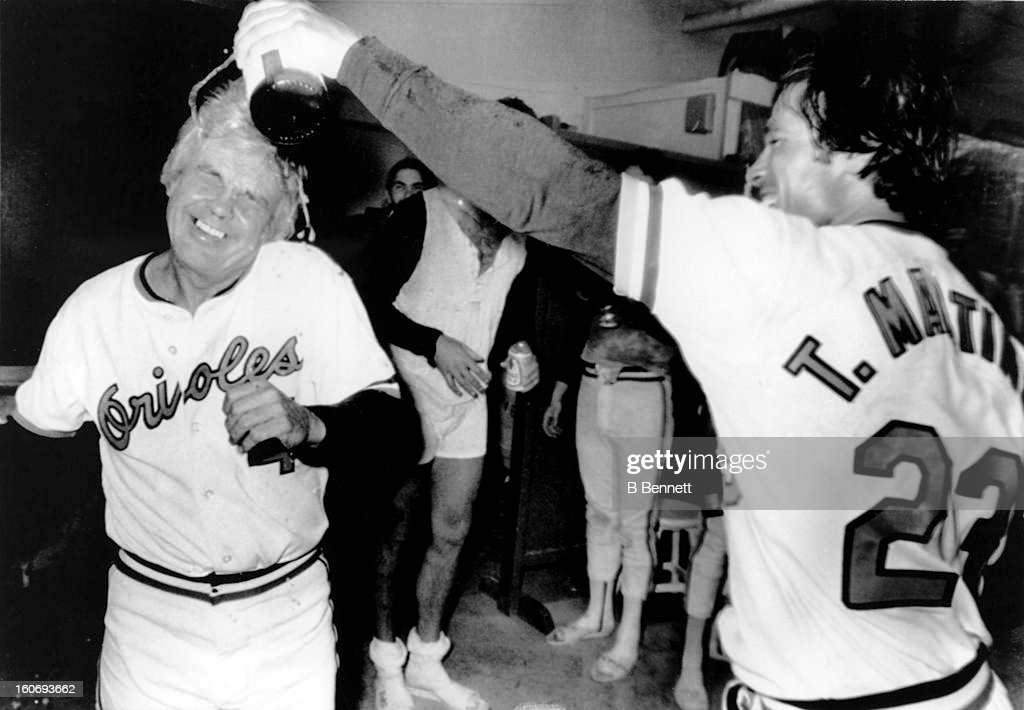 Manager <a gi-track='captionPersonalityLinkClicked' href=/galleries/search?phrase=Earl+Weaver&family=editorial&specificpeople=213180 ng-click='$event.stopPropagation()'>Earl Weaver</a> #4 of the Baltimore Orioles cringes as pitcher Tippy Martinez #23 pours champagne on his head after the Orioles clinced the American League Eastern Division against the Cleveland Indians on September 22, 1979 at the Memorial Stadium in Baltimore, Maryland