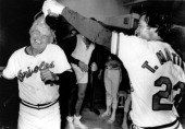 Manager Earl Weaver of the Baltimore Orioles cringes as pitcher Tippy Martinez pours champagne on his head after the Orioles clinced the American...