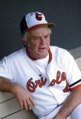 Manager Earl Weaver of the Baltimore Orioles looks on from the dugout during an Major League Baseball game circa 1980 at Memorial Stadium in...