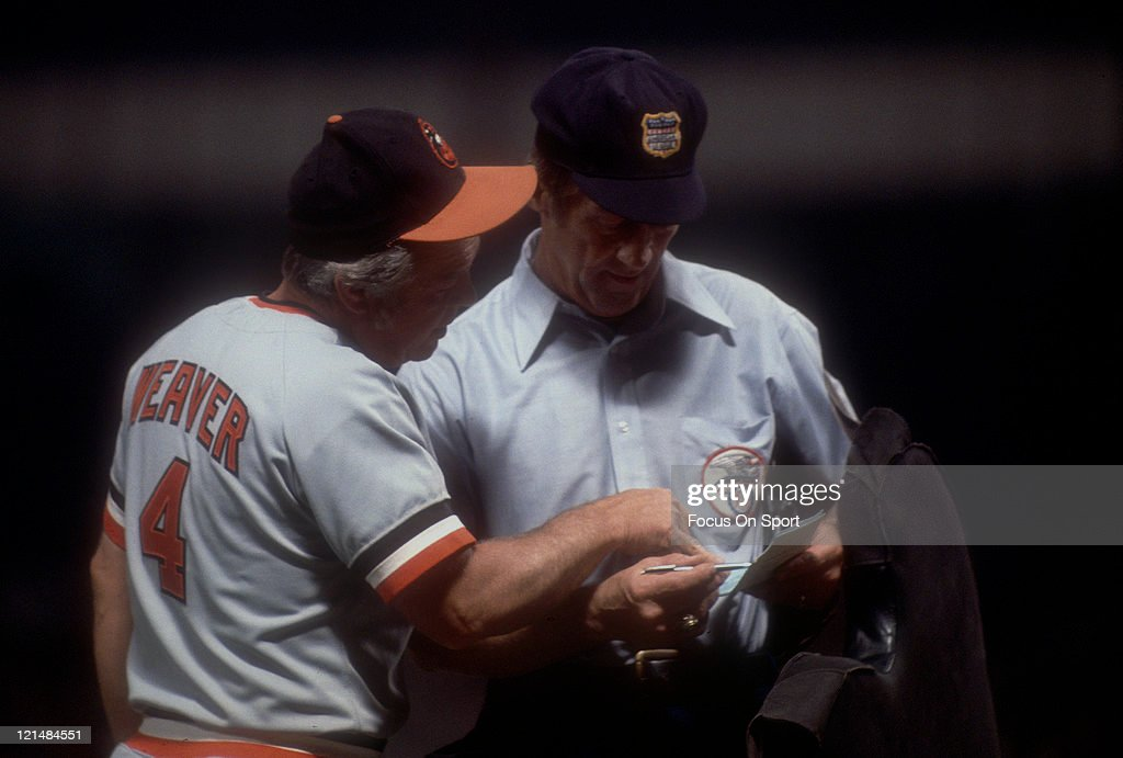 Manager <a gi-track='captionPersonalityLinkClicked' href=/galleries/search?phrase=Earl+Weaver&family=editorial&specificpeople=213180 ng-click='$event.stopPropagation()'>Earl Weaver</a> #4 of the Baltimore Orioles makes a line-up changes with the home plate umpire during a MLB baseball game circa 1978. Weaver managed the Orioles from 1968-82 and 1985-86.