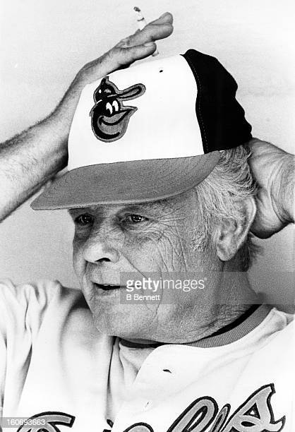 Manager Earl Weaver of the Baltimore Orioles smokes while sitting in the dugout during an MLB game circa 1980