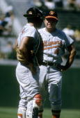 Manager Earl Weaver of the Baltimore Orioles standing on the mound with catcher Clay Dalrymple during a mid 1960's MLB baseball game Weaver Managed...
