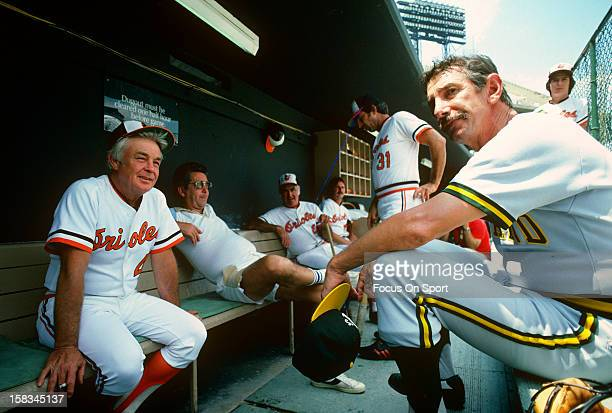 Manager Earl Weaver of the Baltimore Orioles talks with manager Billy Martin of the Oakland Athletics before the start of an Major League Baseball...