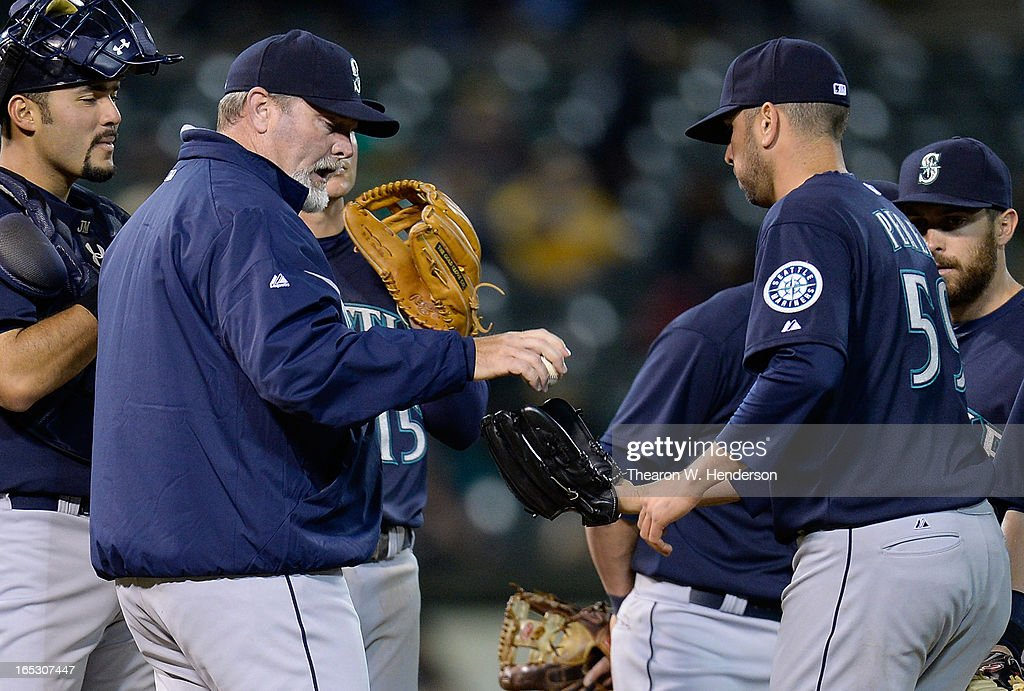 Manager <a gi-track='captionPersonalityLinkClicked' href=/galleries/search?phrase=Eric+Wedge&family=editorial&specificpeople=214257 ng-click='$event.stopPropagation()'>Eric Wedge</a> #22 of the Seattle Mariners gives the ball to relief pitcher <a gi-track='captionPersonalityLinkClicked' href=/galleries/search?phrase=Oliver+Perez&family=editorial&specificpeople=221389 ng-click='$event.stopPropagation()'>Oliver Perez</a> #59 against the Oakland Athletics in the eighth inning at O.co Coliseum on April 2, 2013 in Oakland, California. The Mariners won the game 7-1.