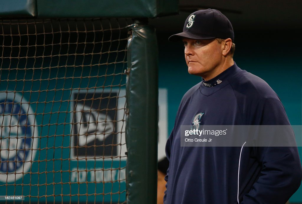 Manager Eric Wedge #22 of the Seattle Mariners looks on against the Oakland Athletics at Safeco Field on September 29, 2013 in Seattle, Washington. The Athletics defeated the Mariners 9-0.