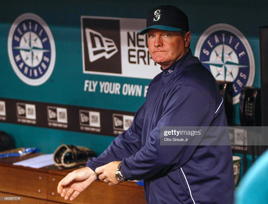 Manager <a gi-track='captionPersonalityLinkClicked' href=/galleries/search?phrase=Eric+Wedge&family=editorial&specificpeople=214257 ng-click='$event.stopPropagation()'>Eric Wedge</a> #22 of the Seattle Mariners looks on from the dugout prior to the game against the Oakland Athletics at Safeco Field on September 27, 2013 in Seattle, Washington. Earlier in the day Wedge announced he would not be returning in 2014.