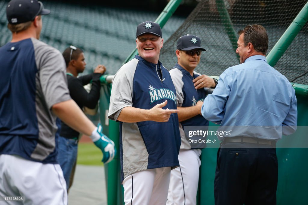 Manager <a gi-track='captionPersonalityLinkClicked' href=/galleries/search?phrase=Eric+Wedge&family=editorial&specificpeople=214257 ng-click='$event.stopPropagation()'>Eric Wedge</a> #22 (C) of the Seattle Mariners smiles during batting practice prior to the game against the Los Angeles Angels of Anaheim at Safeco Field on August 23, 2013 in Seattle, Washington. It was Wedge's first day back after taking time off following a mild stroke.
