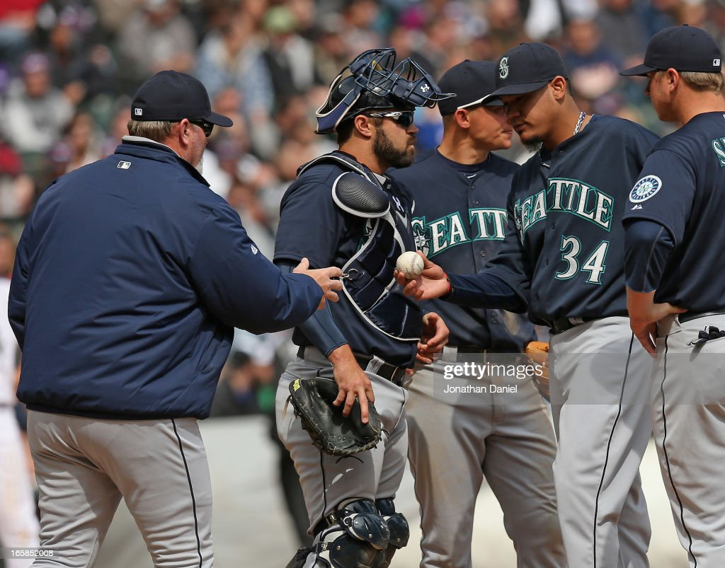 Manager <a gi-track='captionPersonalityLinkClicked' href=/galleries/search?phrase=Eric+Wedge&family=editorial&specificpeople=214257 ng-click='$event.stopPropagation()'>Eric Wedge</a> #22 of the Seattle Mariners takes the ball from starting pitcher <a gi-track='captionPersonalityLinkClicked' href=/galleries/search?phrase=Felix+Hernandez&family=editorial&specificpeople=550749 ng-click='$event.stopPropagation()'>Felix Hernandez</a> #34 during a game against the Chicago White Sox at U.S. Cellular Field on April 6, 2013 in Chicago, Illinois. The White Sox defeated the Mariners 4-3.