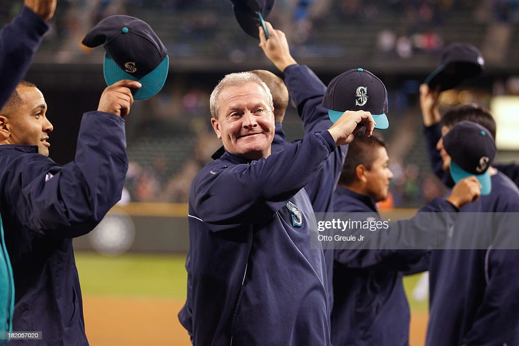 Manager <a gi-track='captionPersonalityLinkClicked' href=/galleries/search?phrase=Eric+Wedge&family=editorial&specificpeople=214257 ng-click='$event.stopPropagation()'>Eric Wedge</a> #22 of the Seattle Mariners waves to the crowd on Fan Appreciation night prior to the game against the Oakland Athletics at Safeco Field on September 27, 2013 in Seattle, Washington. Earlier in the day Wedge announced he would not be returning in 2014.