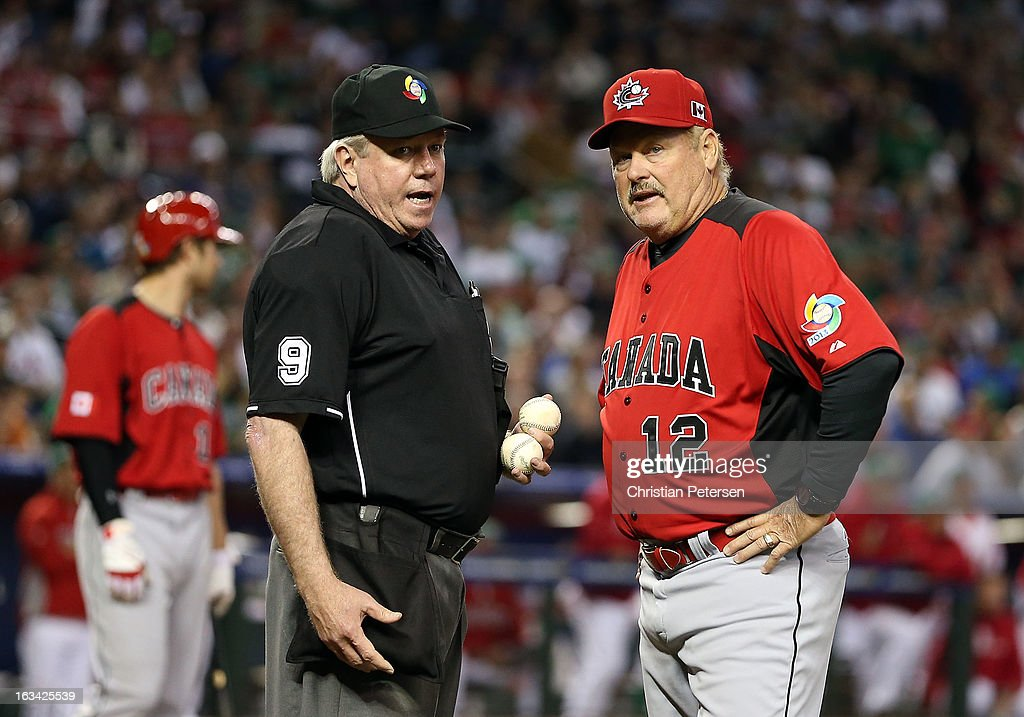 Manager Ernie Whitt of Canada talks with home plate umpire Brian Gorman after objects were thrown onto the field by fans during the World Baseball Classic First Round Group D game against Mexico at Chase Field on March 9, 2013 in Phoenix, Arizona. Canada defeated Mexico 10-3.