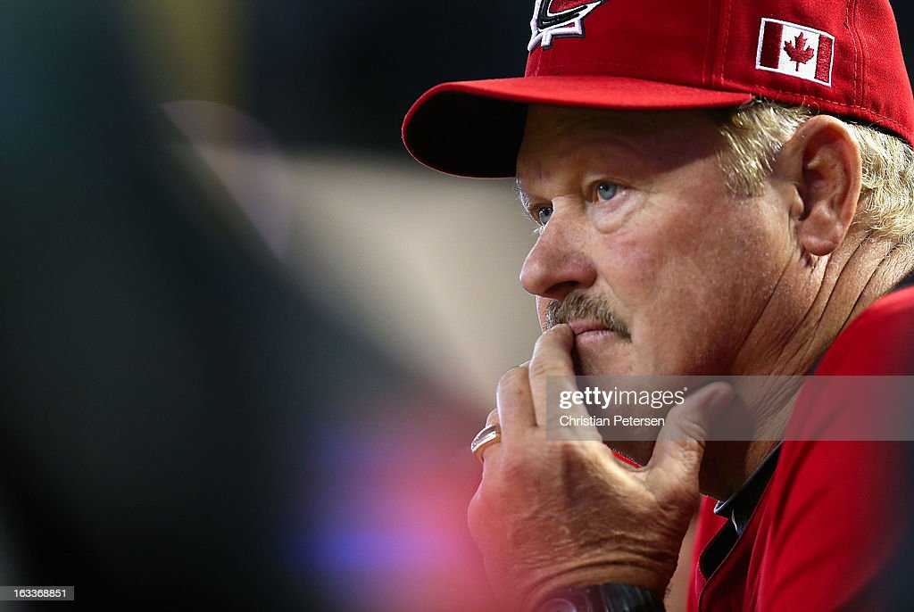 Manager Ernie Whitt of Canada watches from the dugout during the World Baseball Classic First Round Group D game against Italy at Chase Field on March 8, 2013 in Phoenix, Arizona.