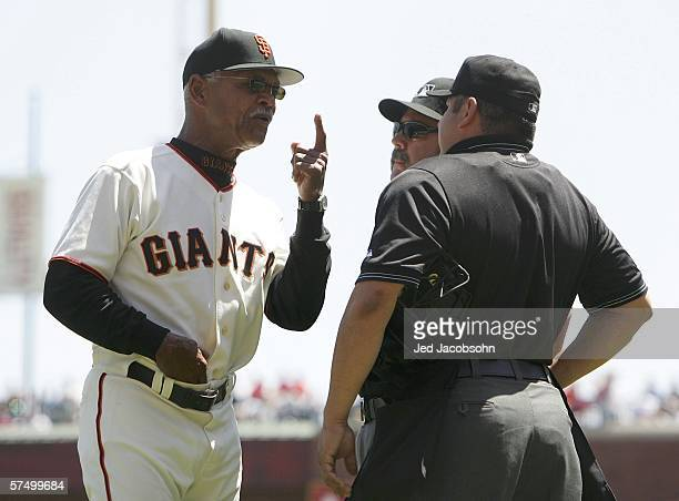 Manager Felipe Alou of the San Francisco Giants challenges home plate umpire Ramon Armendariz after Barry Bonds was called out on strikes in the...