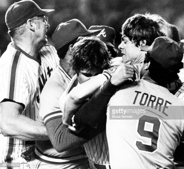 Manager Frank Howard of the New York Mets and manager Joe Torre of the Atlanta Braves try to break up the fight between Dave Kingman of the Mets and...