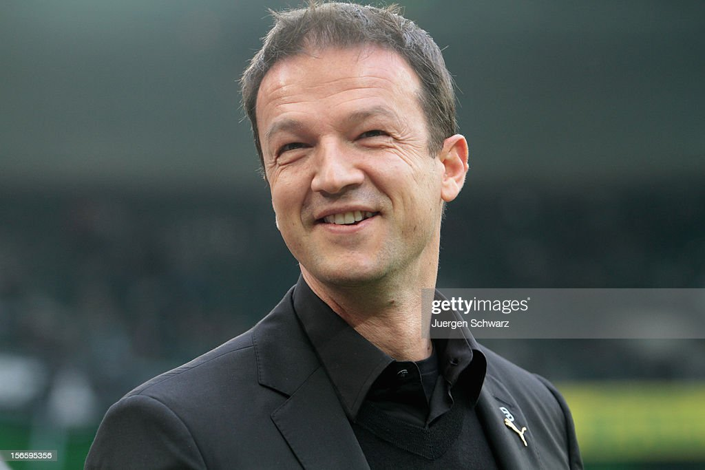 Manager <a gi-track='captionPersonalityLinkClicked' href=/galleries/search?phrase=Fredi+Bobic&family=editorial&specificpeople=3647927 ng-click='$event.stopPropagation()'>Fredi Bobic</a> of Stuttgart smiles at the Bundesliga match between Borussia Moenchengladbach and VfB Stuttgart at Borussia Park Stadium on November 17, 2012 in Moenchengladbach, Germany.