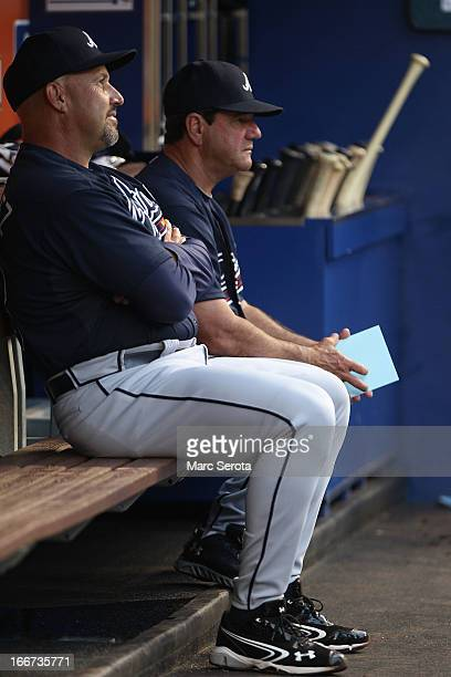 Manager Fredi Gonzalez of the Atlanta Braves in the duggout against the Miami Marlins at Marlins Park on April 10 2013 in Miami Florida The Braves...