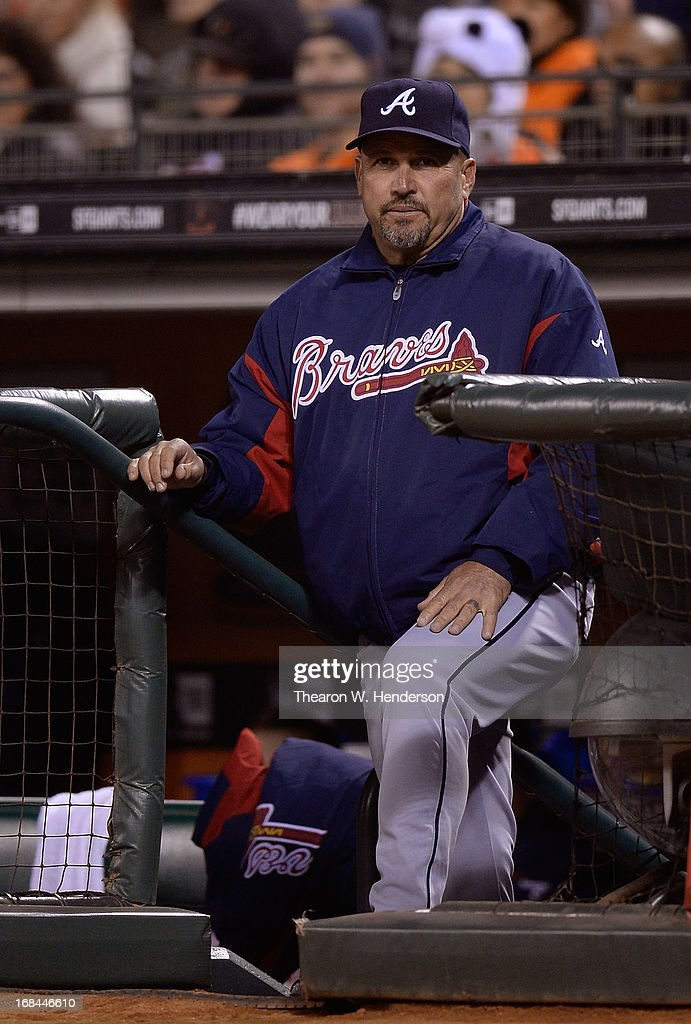 Manager <a gi-track='captionPersonalityLinkClicked' href=/galleries/search?phrase=Fredi+Gonzalez&family=editorial&specificpeople=686896 ng-click='$event.stopPropagation()'>Fredi Gonzalez</a> #33 of the Atlanta Braves looks on from the steps of the dugout against the San Francisco Giants in the fourth inning at AT&T Park on May 9, 2013 in San Francisco, California.