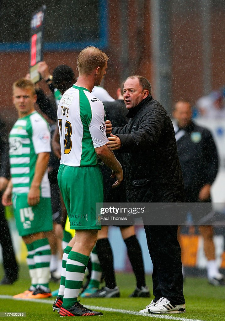 Manager Gary Johnson (R) of Yeovil talks to his player Alan Tate during the Sky Bet Championship match between Burnley and Yeovil Town at Turf Moor on August 17, 2013 in Burnley, England