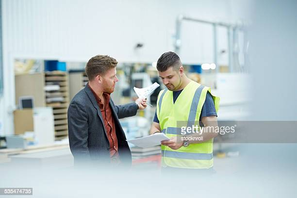 Manager giving orders to an employee